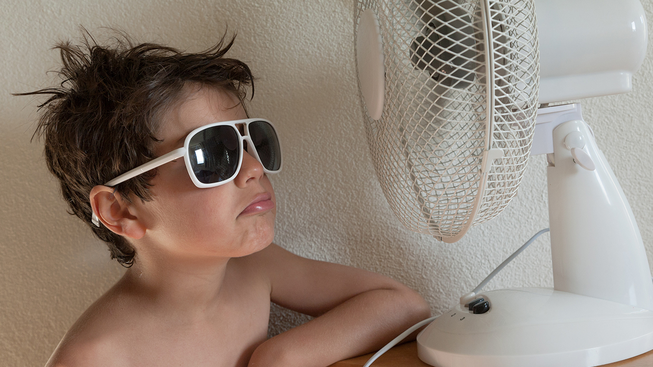 sweaty kid summer time cools down